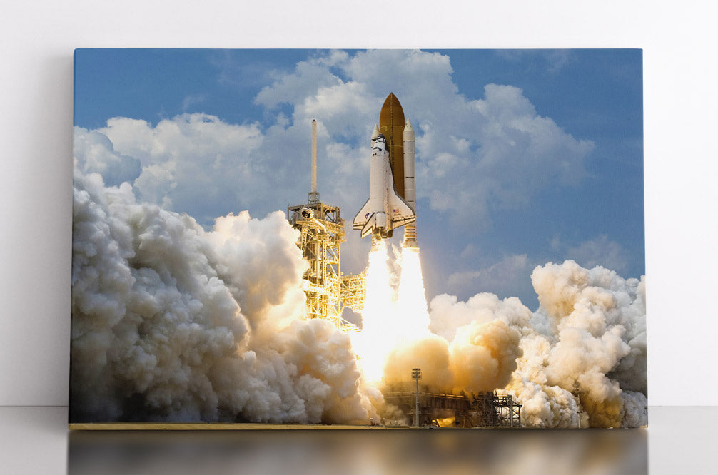 Atlantis shuttle blasting off into outer space, canvas wall art in room.