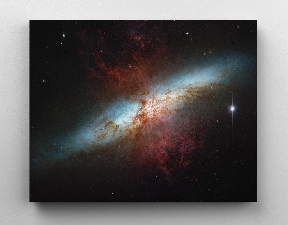 The Cigar Galaxy (M82/NGC 3034), Hubble Space Telescope image. Canvas wall art in room.