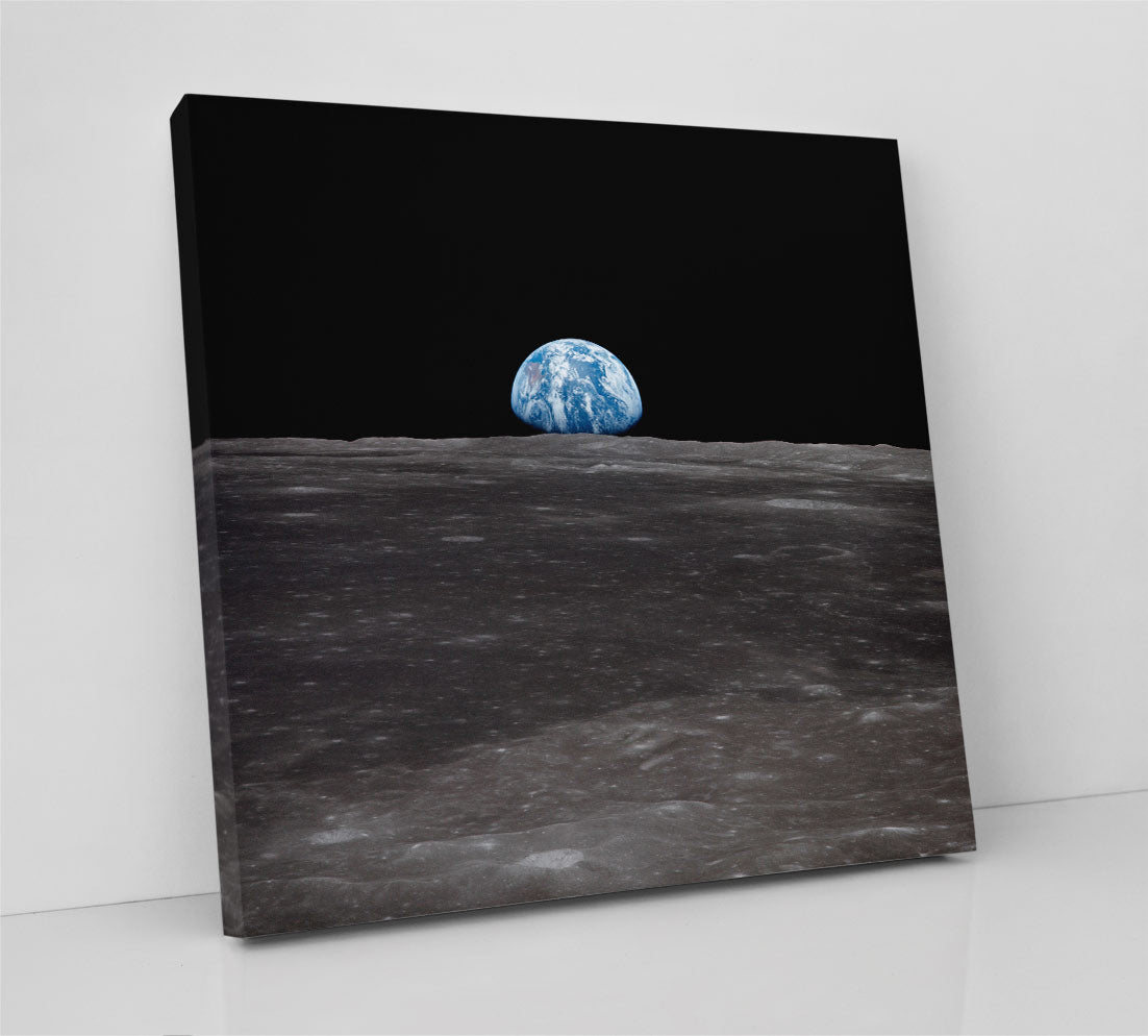 Planet Earth, as seen from the Moon during the NASA Apollo mission, in the famous Earthrise photo. Canvas wall art in room.