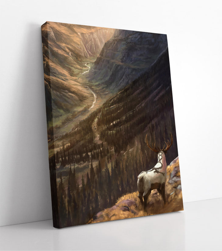 Mysterious antelope creature with antlers and a cool pattern on his back overlooks forested, valley landscape. Canvas wall art in room.
