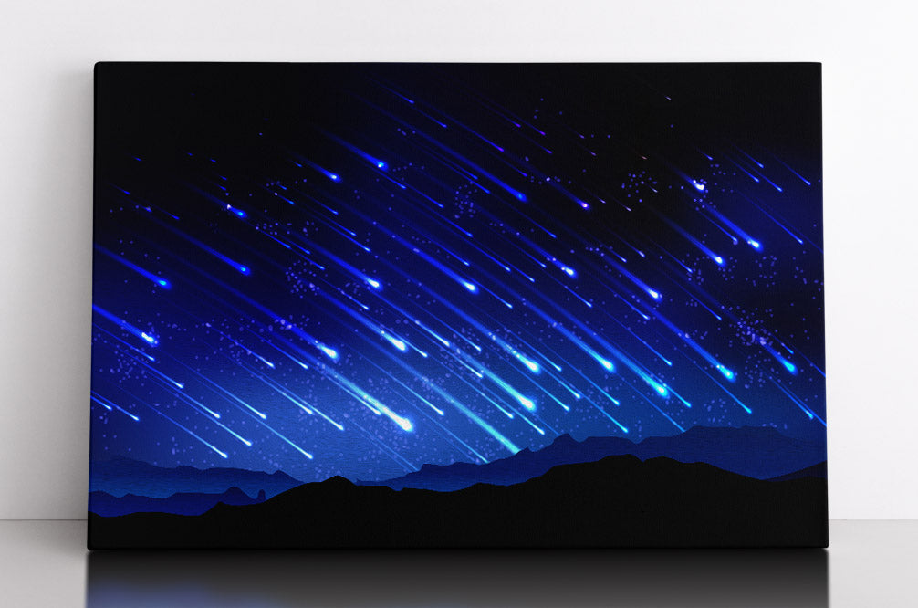 Glowing blue meteor shower in sky with mountains. Canvas wall art in room.