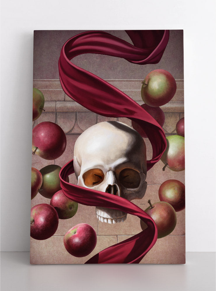 Human skull floating in the air with a red, velvet ribbon spiraled around it, surrounded by floating apples. Canvas wall art in room.
