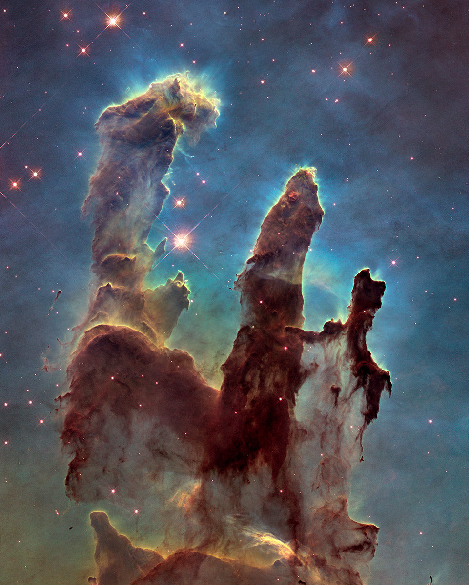 The Pillars of Creation (in the Eagle Nebula), as imaged by the Hubble Telescope.