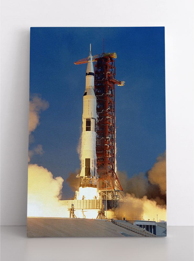 Saturn V rocketship launching into space, NASA image. Canvas wall art in room.