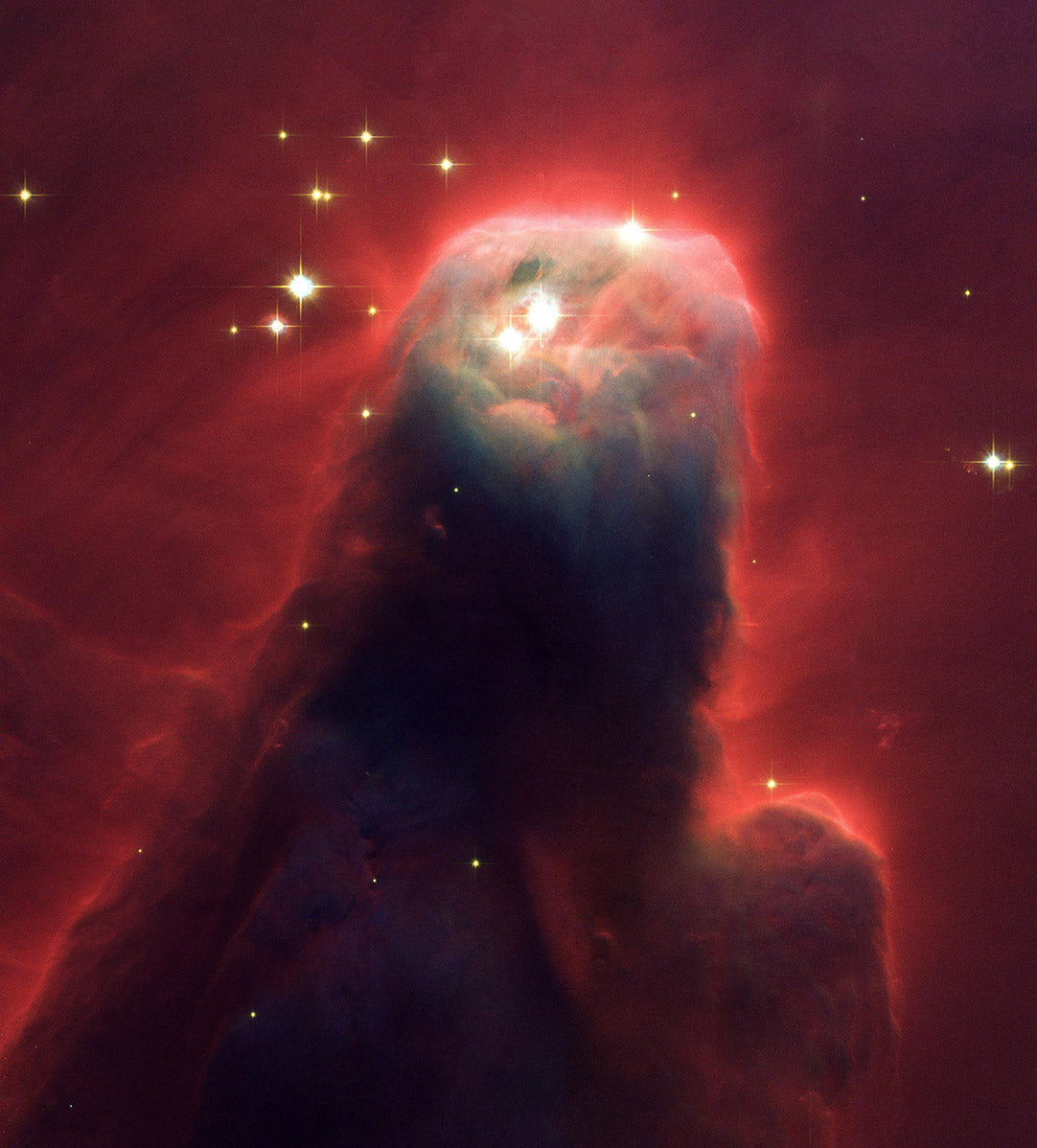 The Cone Nebula (NGC 2264), as photographed by The Hubble Space Telescope.