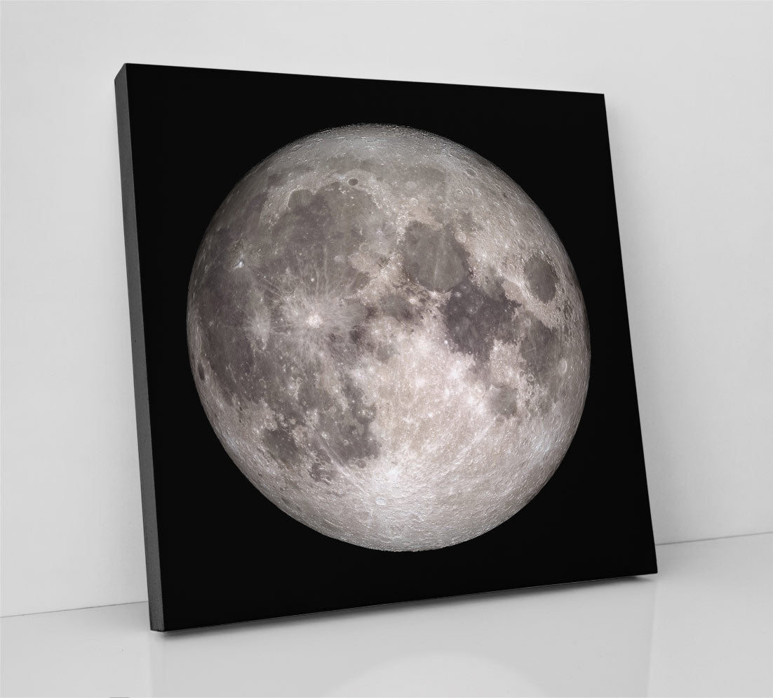 The full moon, in outer space, detailed with craters and ejecta. Canvas wall art in room.