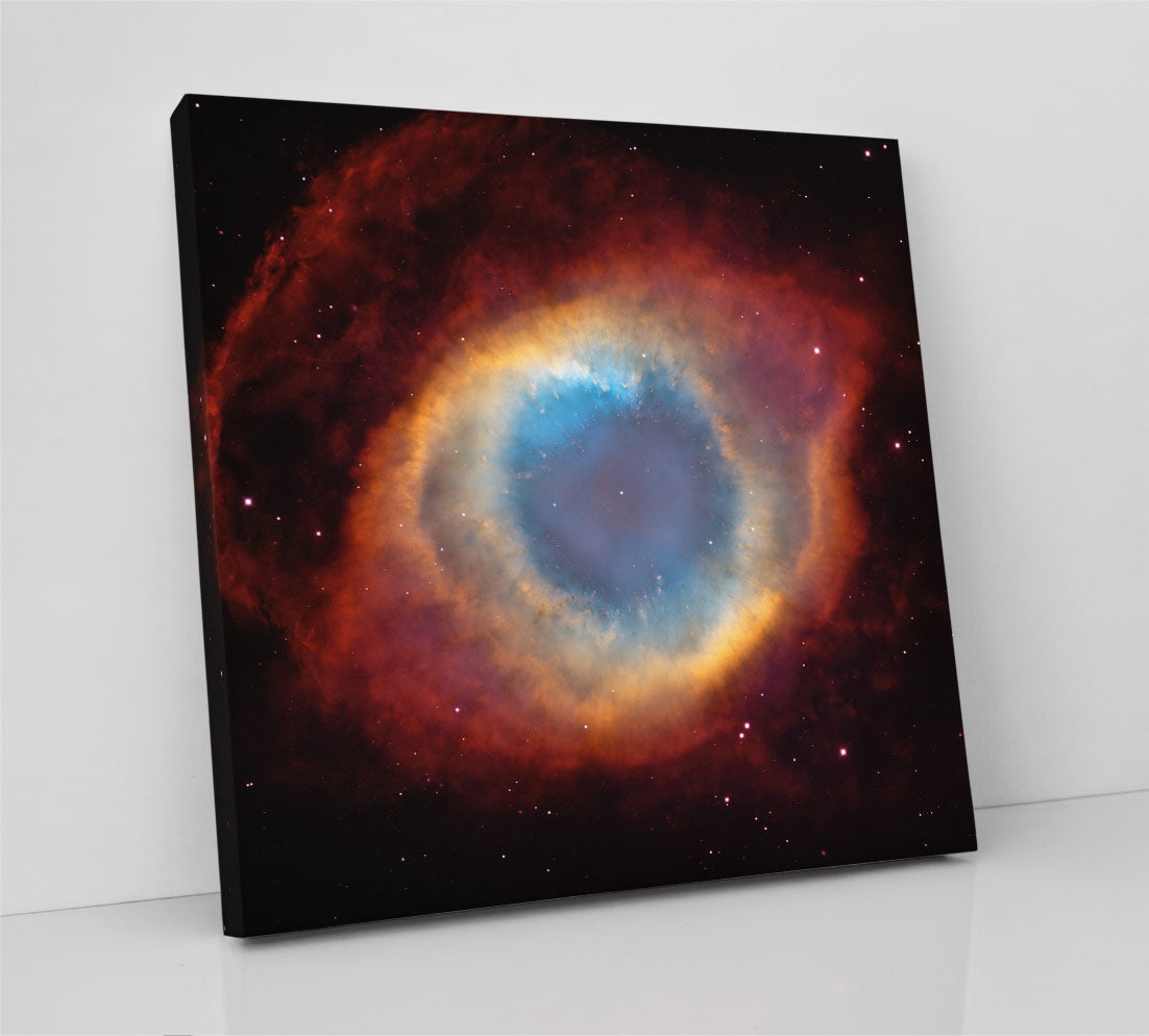 The Helix Nebula (NGC 7293), planetary nebula imaged by the Hubble Space Telescope. Canvas wall art in room.