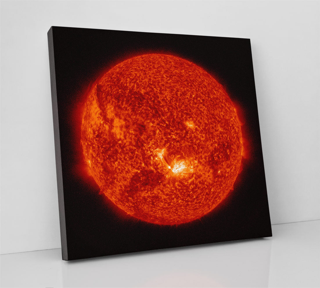 The sun, detailed image from NASA in outer space. Canvas wall art in room.