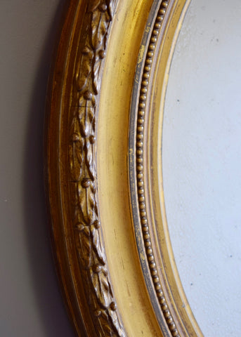 Pair of Distressed Water Gilt Oval Mirrors
