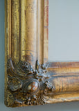 Closeup of French Crested Antique Mirror | Rough Old Glass