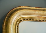 Closeup of Engraved French Crested Antique Mirror | Rough Old Glass