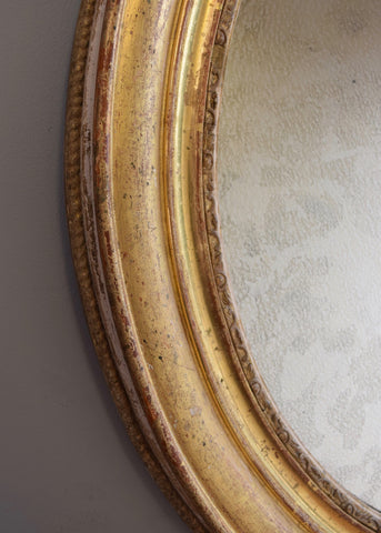 Pair of Gilt Oval Mirrors