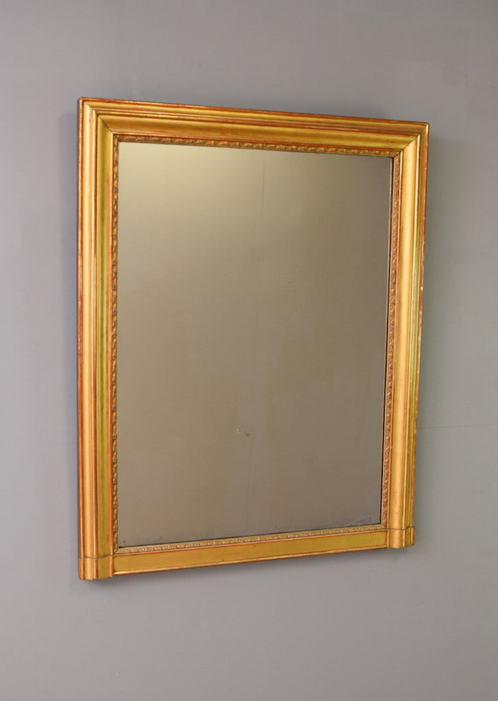 Late 19th Century French Gilt Mirror with Warm Terracotta Bole