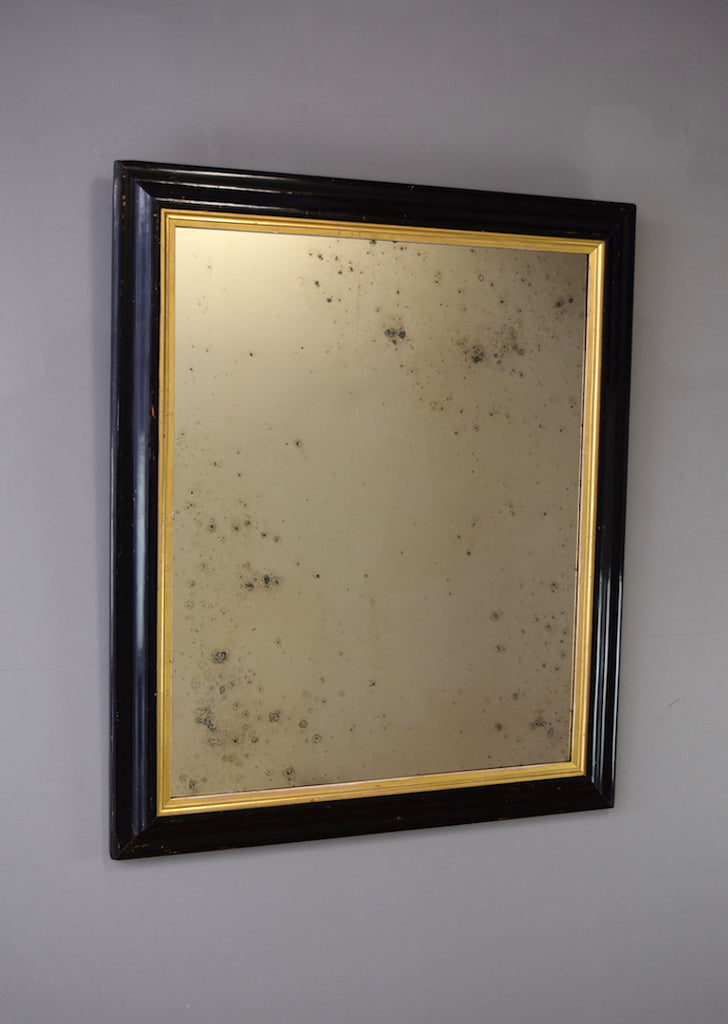 Early 19th Century Ebonised Mirror with Gold Gilt Slip