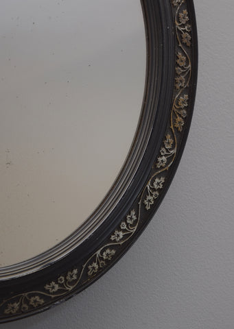 Pair of Ebonised Oval Mirrors