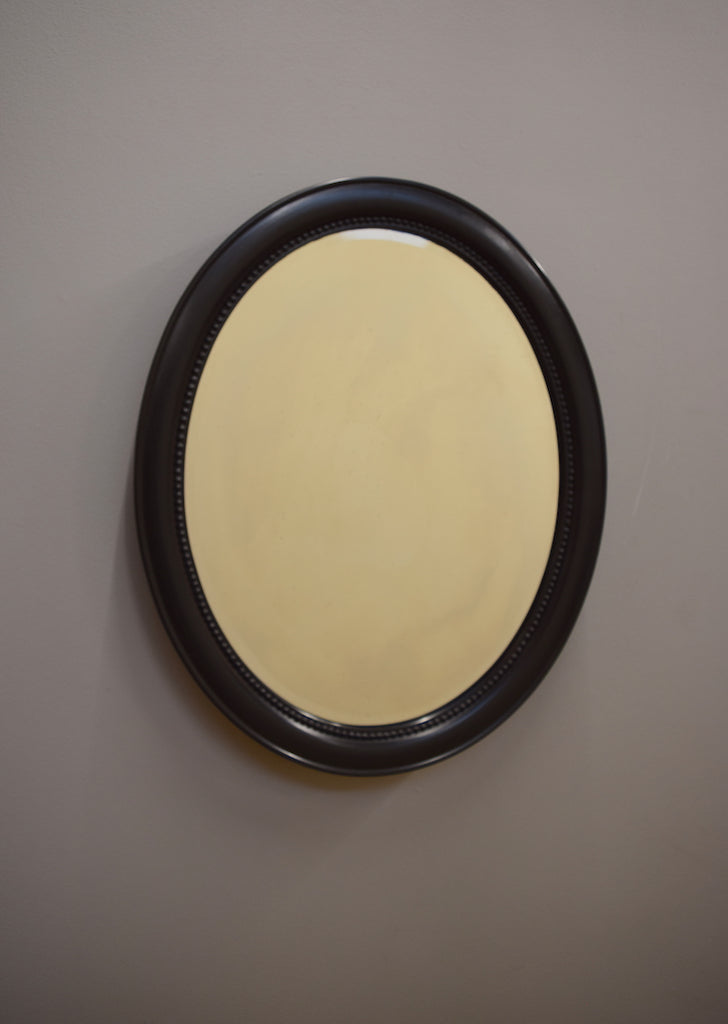 English Ebonised Oval Mirror