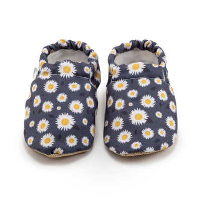 infant shoes with daisy flower prints on blue canvas