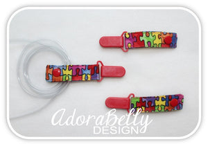 Autism AdoraClip - Tubie Clip (Gtube, IV, Ventilator tube connection) Puzzle Pieces Red