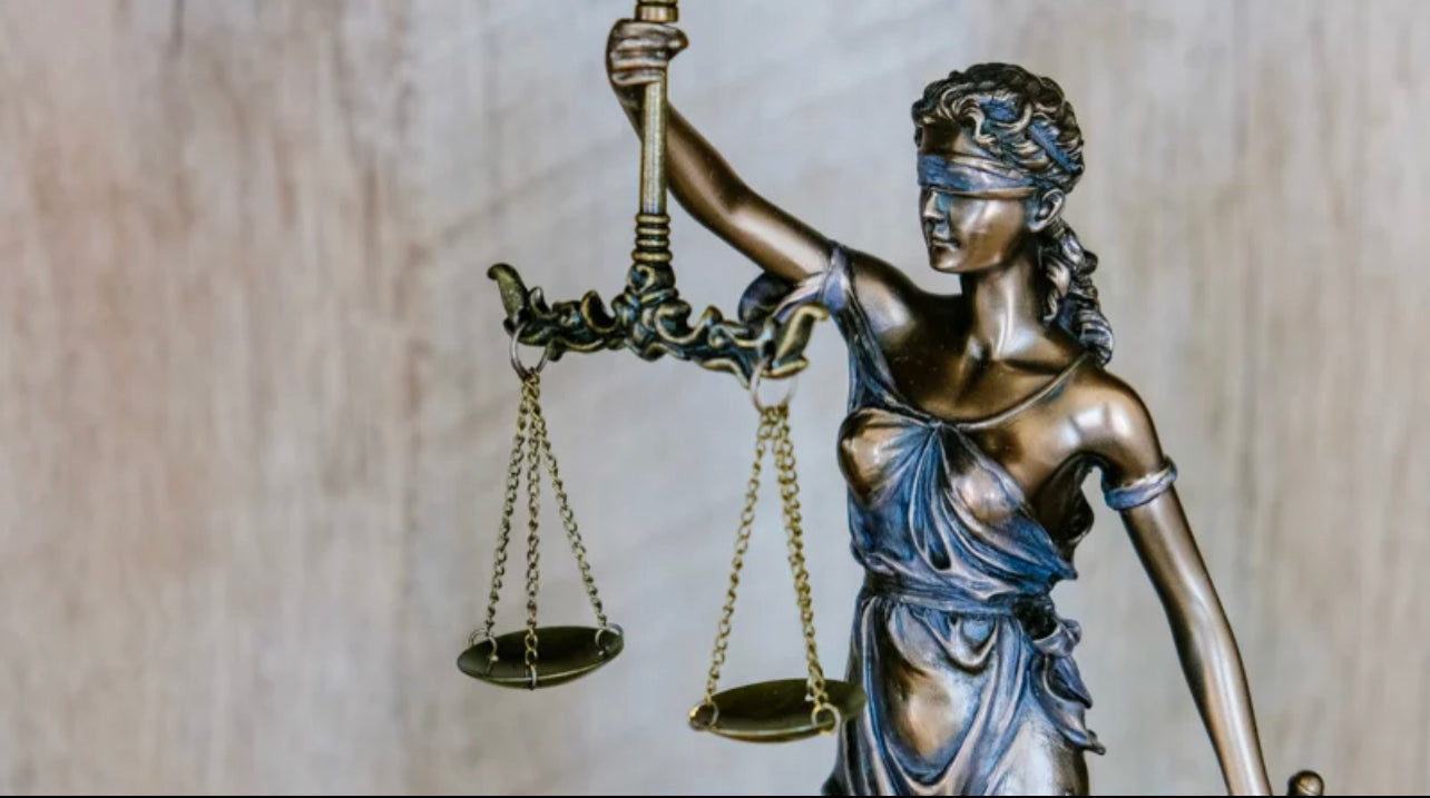 Statue of justice balancing a scale