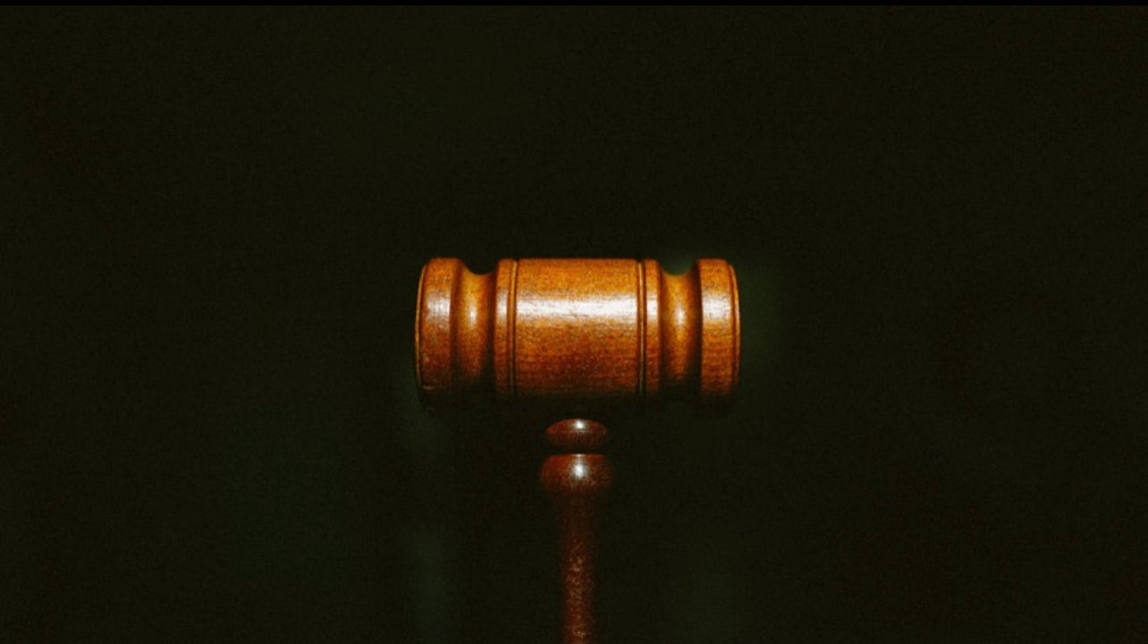 image of the judge mallet on black background
