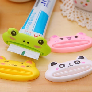 5PCS Cute Cartoon Bathroom Tube Rolling Holder Easy Squeezer Toothpaste Dispenser ( Color Random )