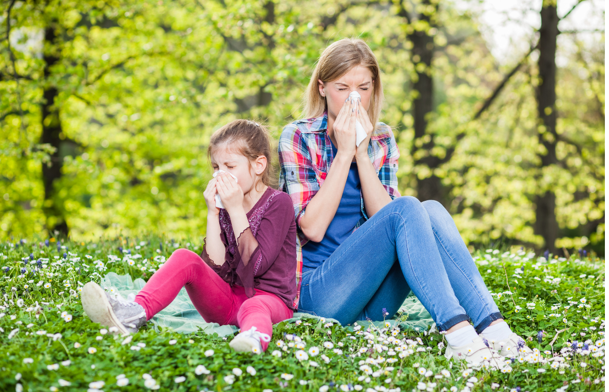 Woman and girl sneezing