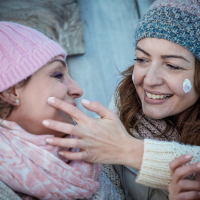 Applying facial products in winter