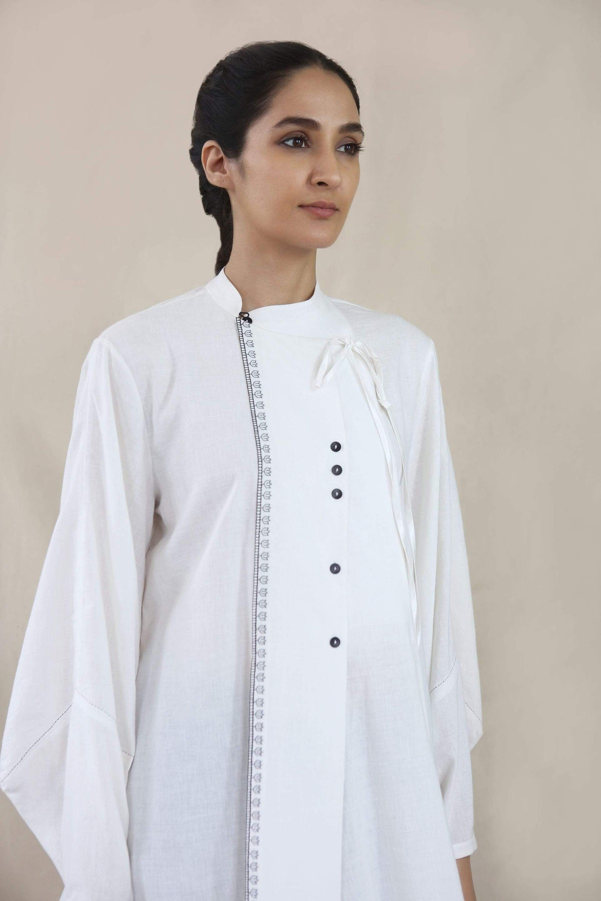 Integument Shirts & Tops Ivory top with floret embroidery