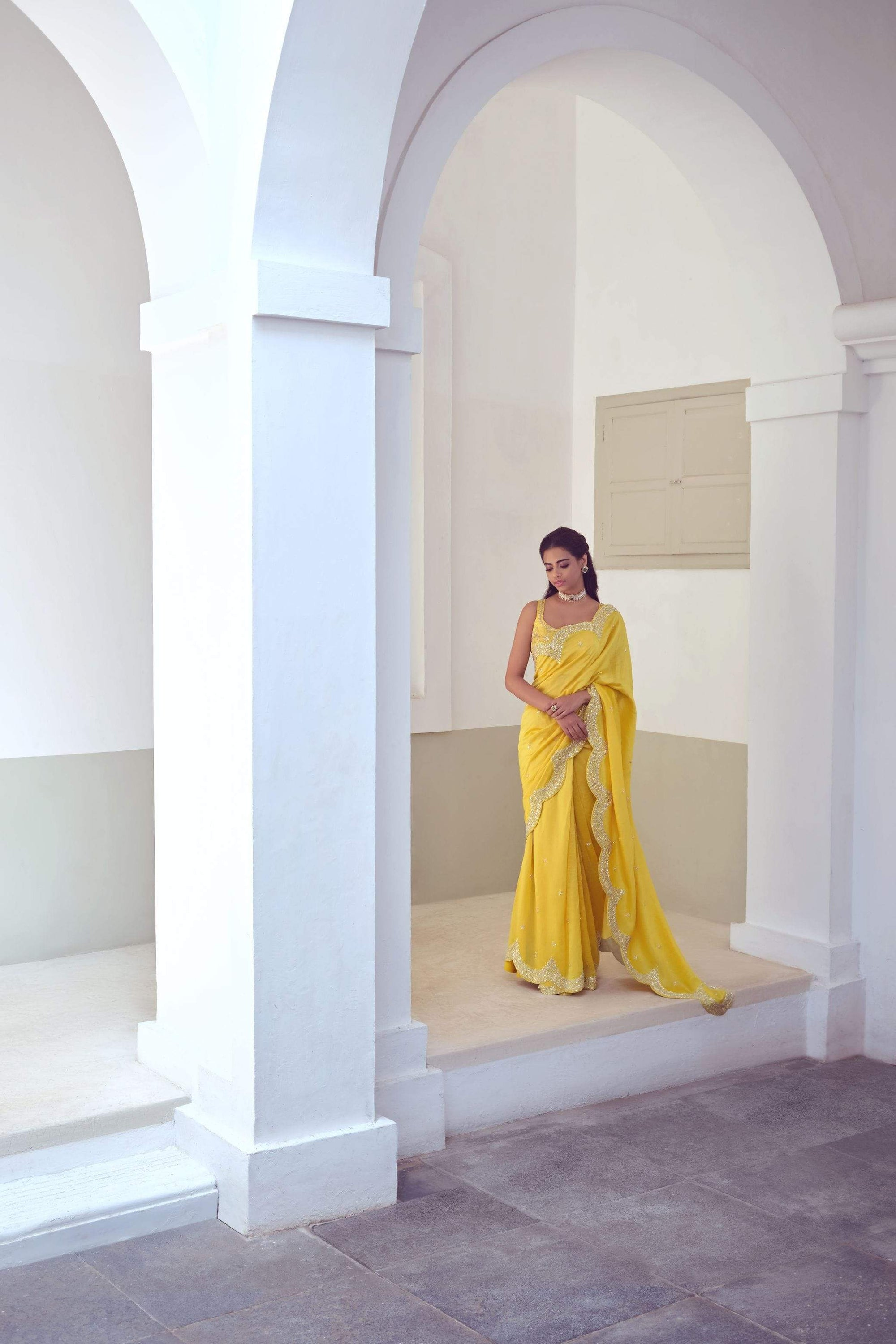 Mishru Sarees Mustard scallop embroiered saree with blouse.