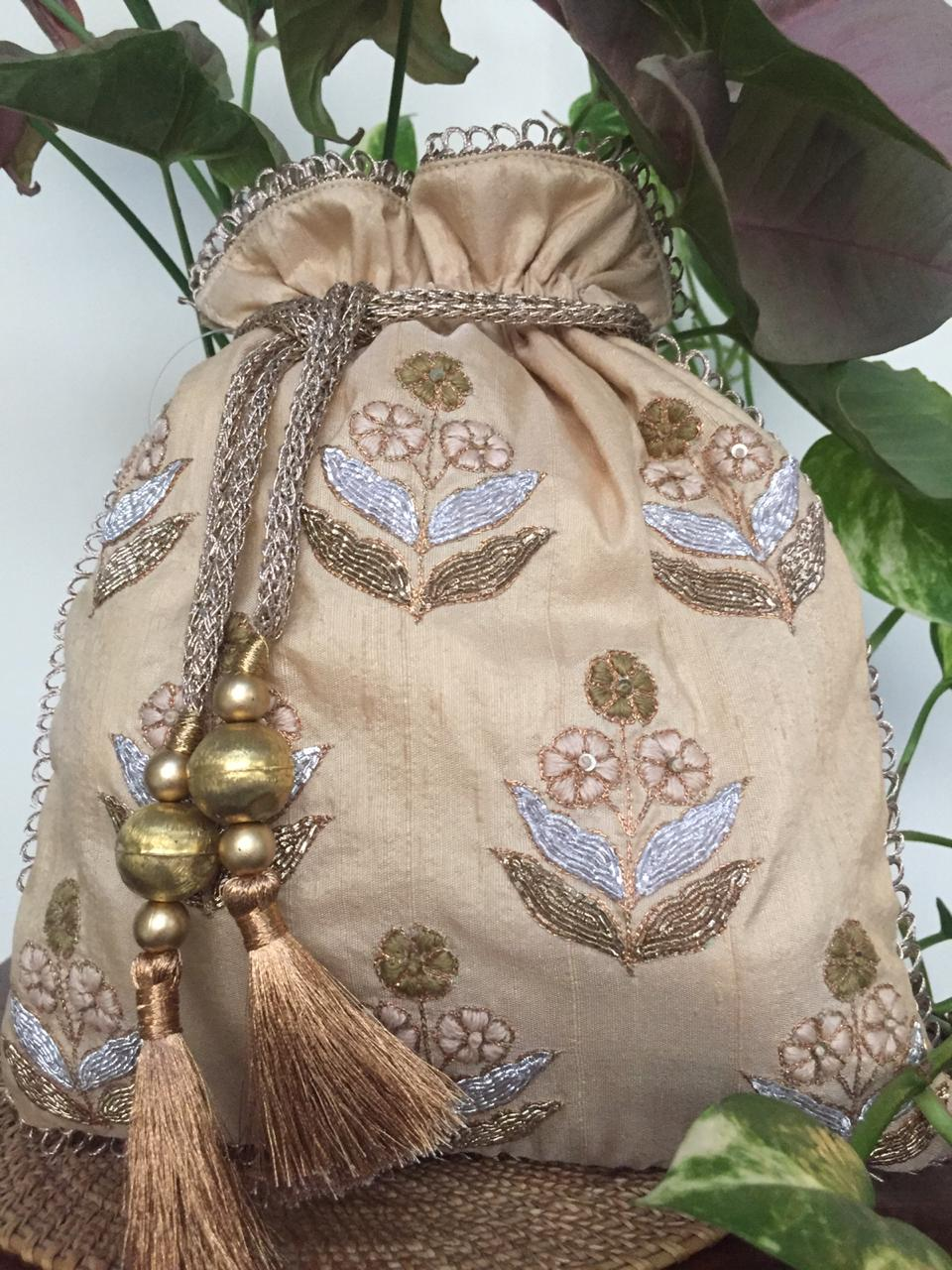 Nidhi Agarwal Bags & Clutches Embellished peach potli with tassels