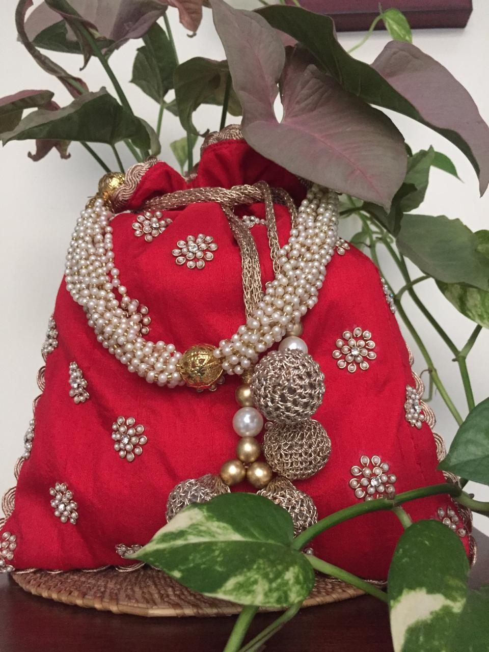 Nidhi Agarwal Bags & Clutches Mothi motif red potli