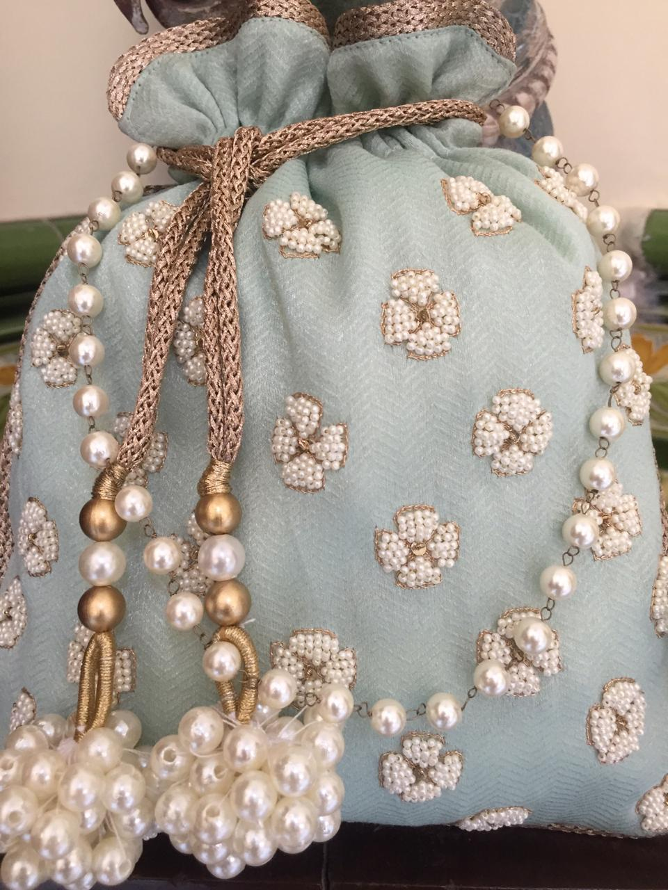 Nidhi Agarwal Bags & Clutches Powder blue and pearls potli