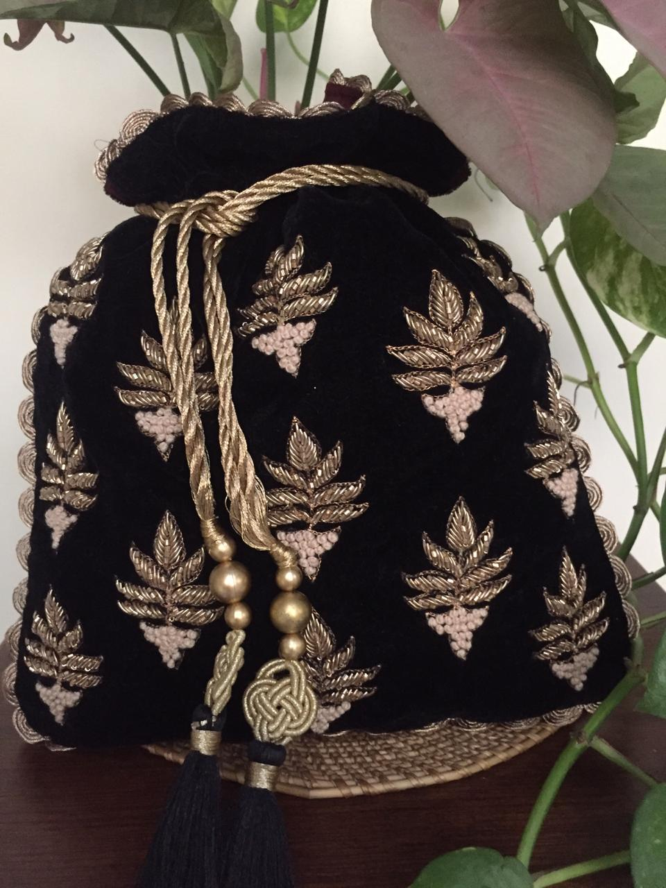 Nidhi Agarwal Bags & Clutches Sequinced leaves in black potli