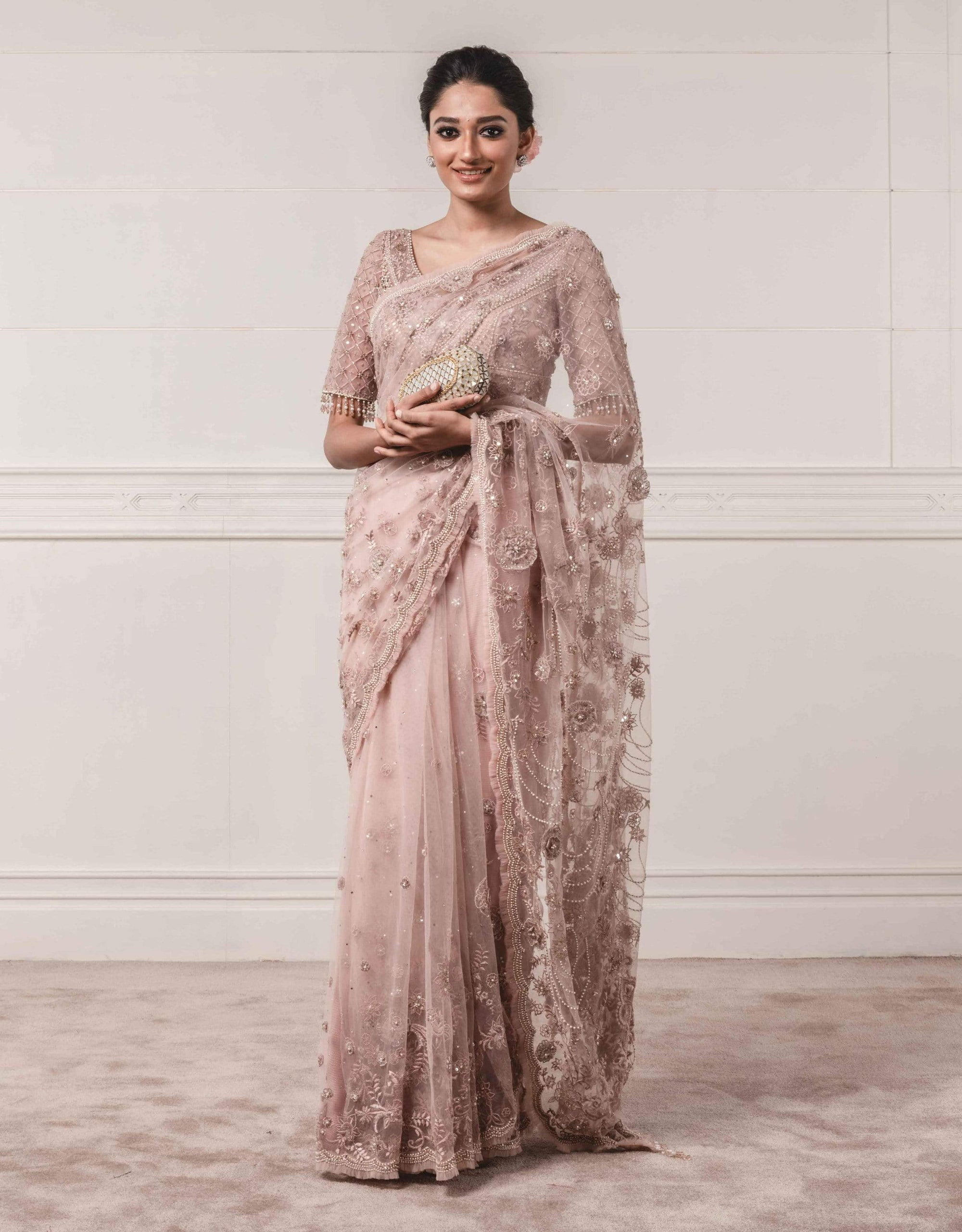 Tarun Tahiliani Sarees Resham embroided saree paired with a blouse and a petticoat.