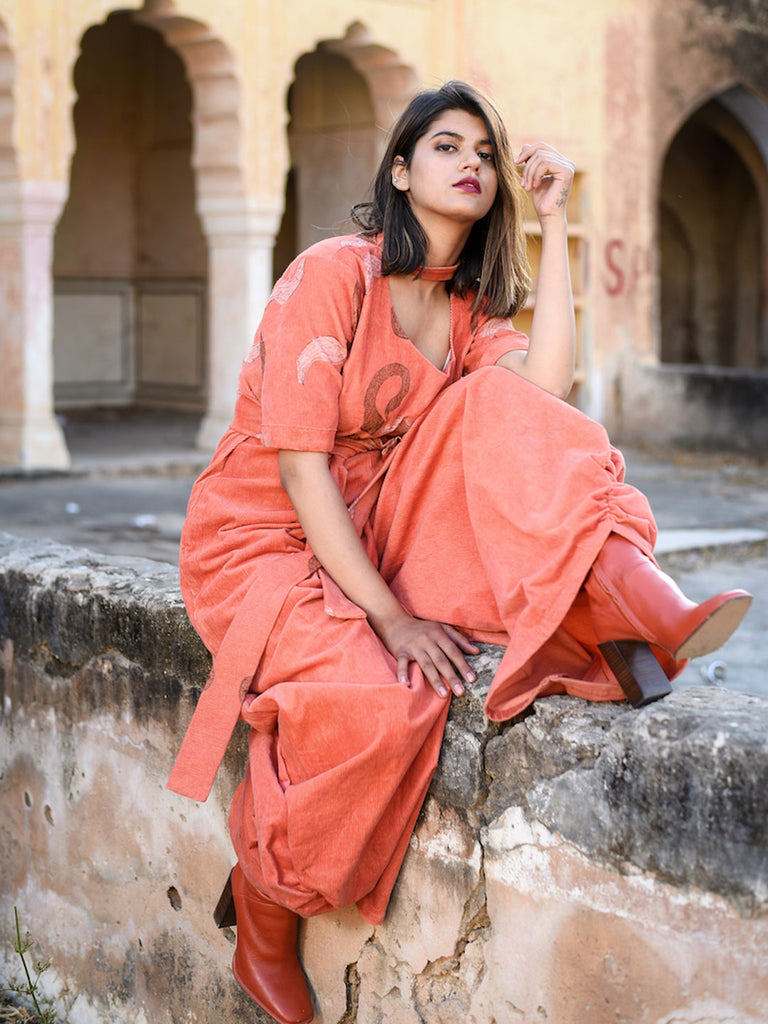 Orange Jumpsuit with Drapes