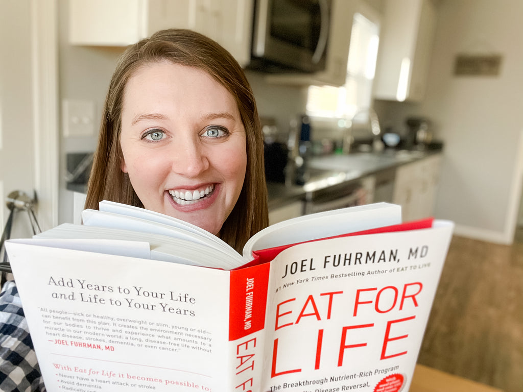 Image of Taryn with Eat for Life book