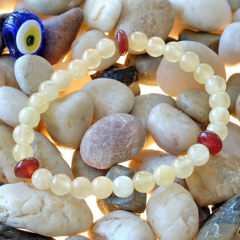 Orange Calcite Bracelet - Akiki™ Natural healing crystals - Customizable in length and bead size - Free jewelry pouch - Saatwa