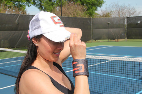 Court Crate Athlete wearing custom tennis wristband by Wristpect Sport