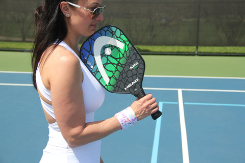 Pickleball player wearing Wristpect Sport wristband