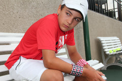 Lucas Brown Junior Tennis Player Wearing Wristpect Sport Crimson Tide Wristband Set