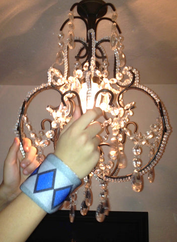 Wristpect Sport wristbands swing from the chandeliers