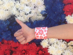 Wristpect Sport Love Blossom wristband shown in USA colored carnations