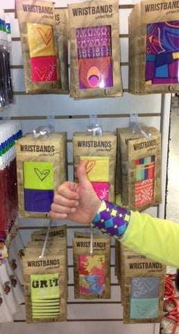 Wristpect Sport wristbands hanging on shelves of top tennis retailers and clubs