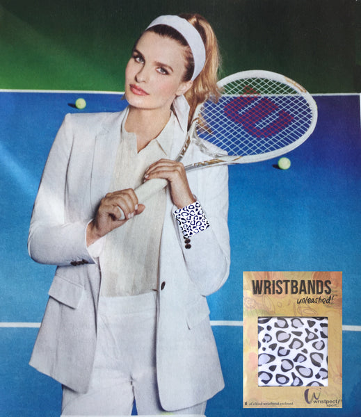 Tennis model with Wristpect Sport snow leopard wristband