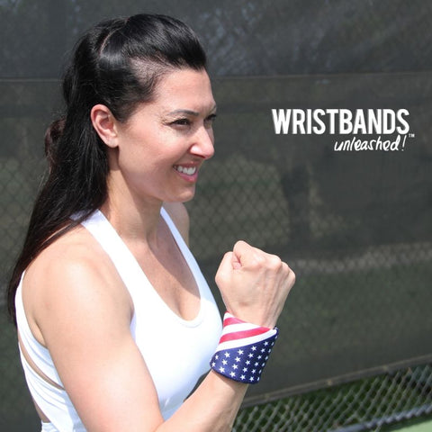 Kim with fist pump wearing Stripes from stars and stripes double wristband package