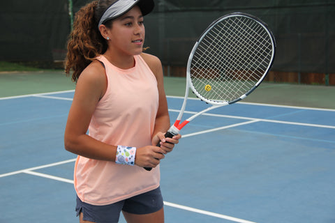 Tennis player wearing Fashion wristband by Wristpect Sport