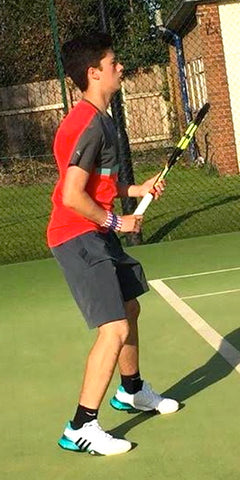 British junior tennis player Matt Hunt in action on tennis court wearing Wristpect Sport spirit wristband