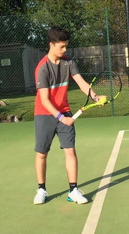 British junior tennis player Matt Hunt serving at baseline