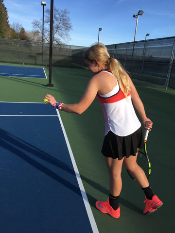 Kamryn Taub- junior tennis player shown wearing Wristpect Sport U.S. flag wristband