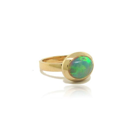 Opal And Yellow Gold Bezel Set Ring